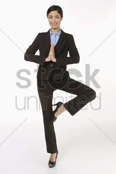 businesswoman in a yoga position stock photo