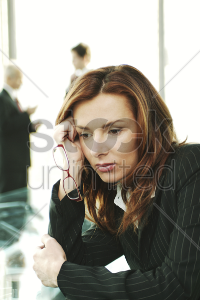 businesswoman in deep thought stock photo