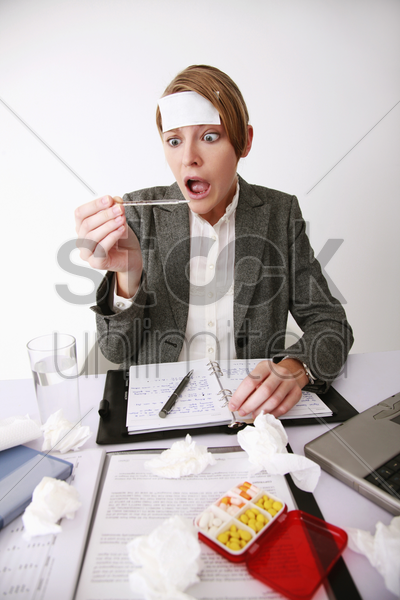 businesswoman in shock after looking at the thermometer stock photo