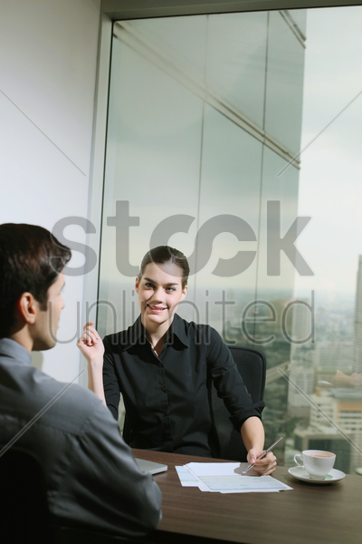 businesswoman interviewing a candidate stock photo