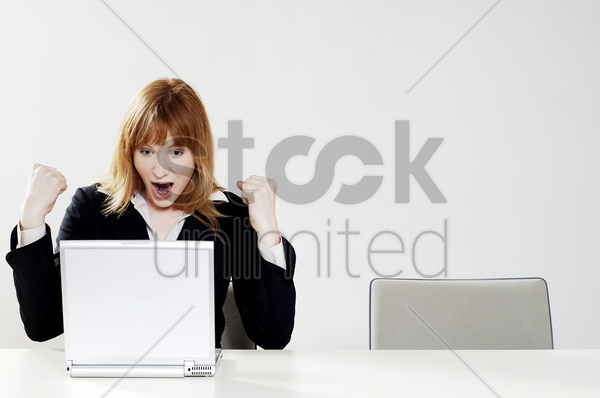 businesswoman jubilating after getting the good news stock photo