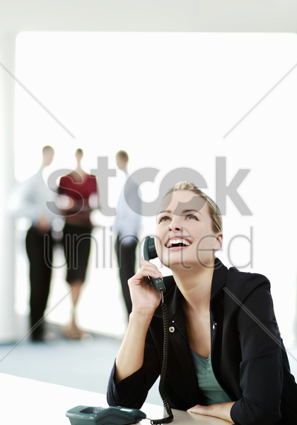 businesswoman laughing while talking on the phone stock photo
