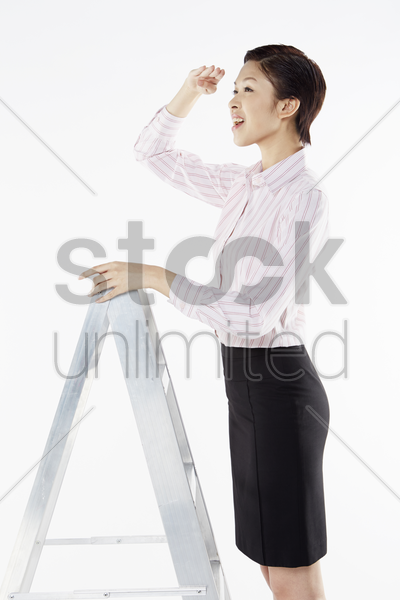 businesswoman looking ahead stock photo