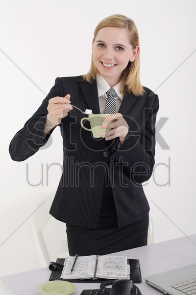 businesswoman making a cup of coffee stock photo