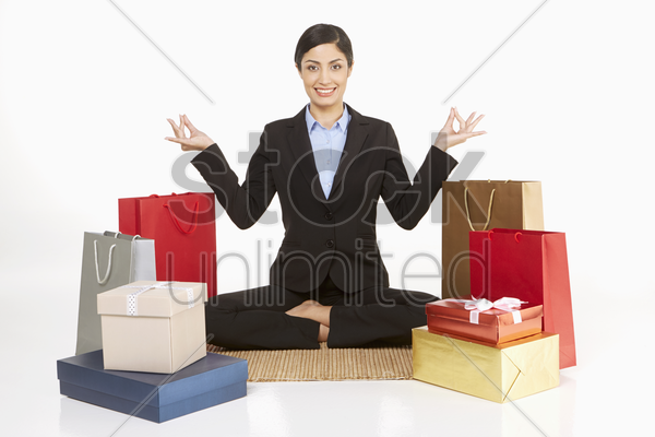 businesswoman meditating while sitting on the floor stock photo