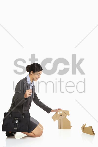 businesswoman petting a paper dog stock photo