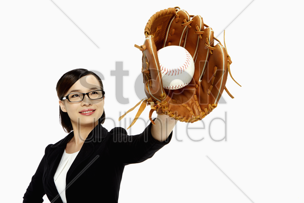 businesswoman playing baseball stock photo