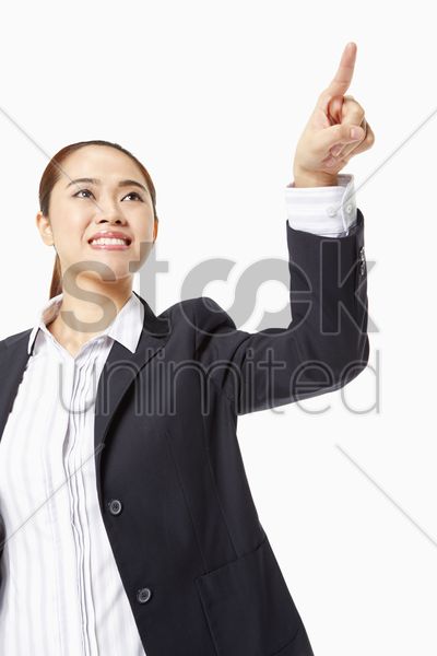 businesswoman pointing to the left stock photo