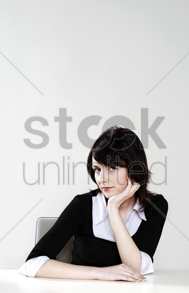 businesswoman posing for the camera stock photo