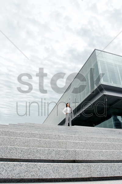 businesswoman posing on the stairs stock photo