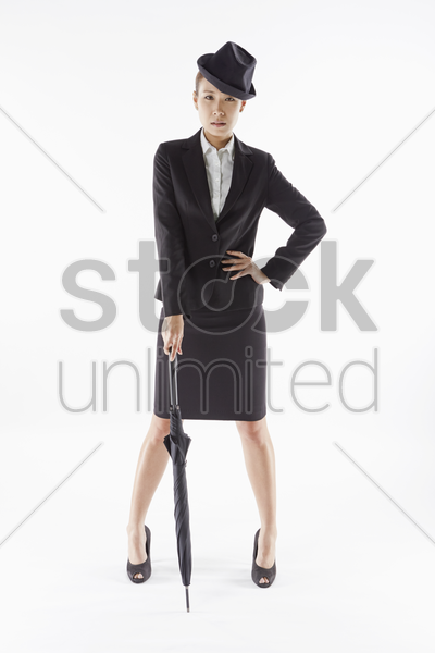 businesswoman posing with an umbrella stock photo
