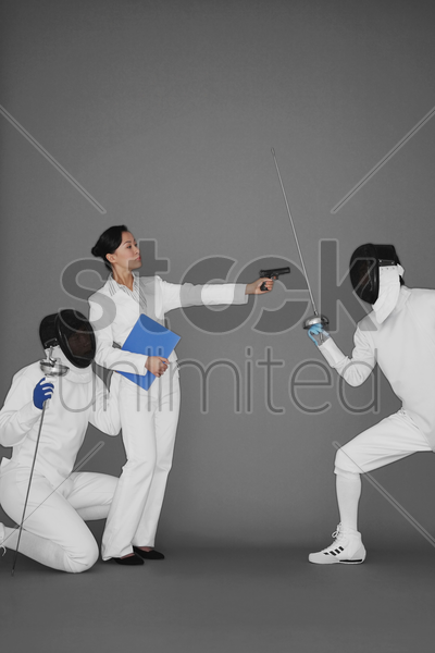 businesswoman protecting a man by holding a gun at his opponent stock photo