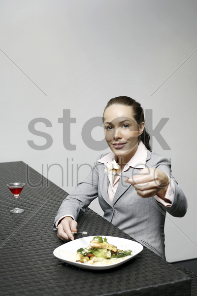businesswoman sharing her food stock photo