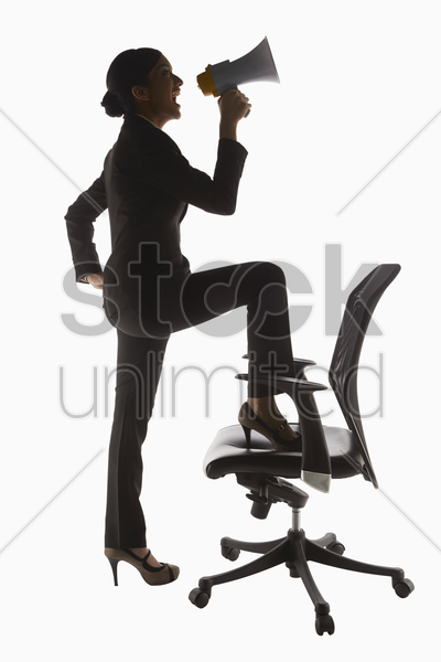 businesswoman shouting into a megaphone stock photo