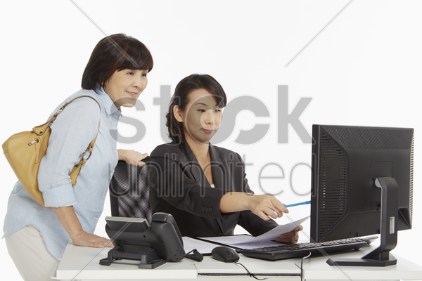 businesswoman showing customer information on the computer screen stock photo