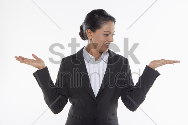 businesswoman showing hand gesture, facing left stock photo