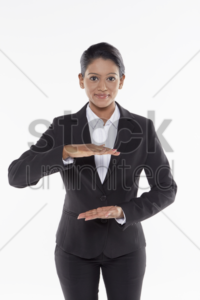 businesswoman showing hand gesture stock photo