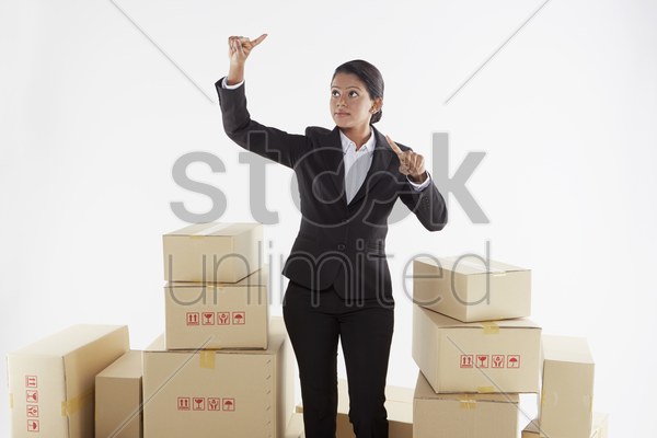 businesswoman showing hand gestures stock photo