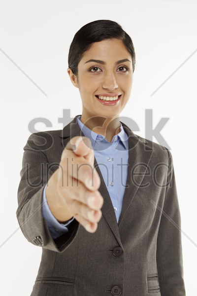 businesswoman showing hand greeting gesture stock photo