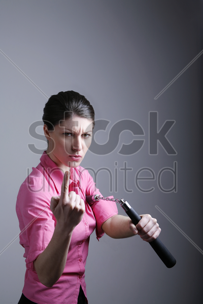 businesswoman showing off his martial art skill stock photo