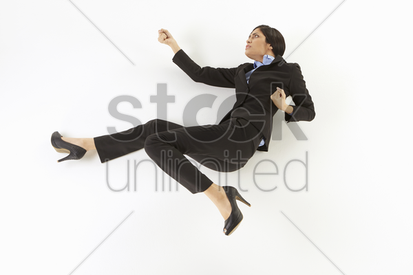 businesswoman showing punching and kicking gesture stock photo