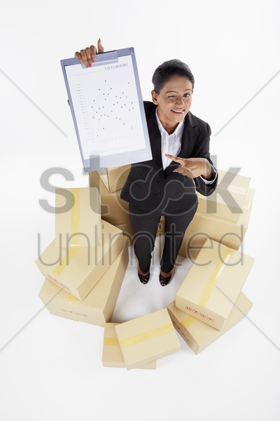 businesswoman showing sales report document stock photo