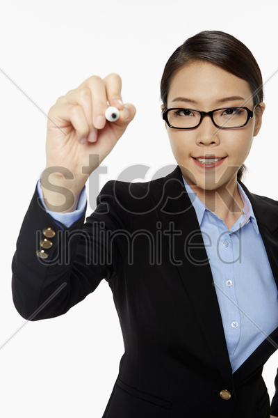 businesswoman showing writing gesture stock photo