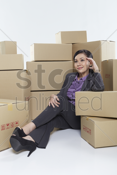 businesswoman sitting and contemplating stock photo