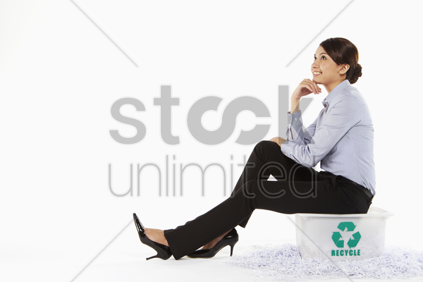 businesswoman sitting on a plastic box stock photo
