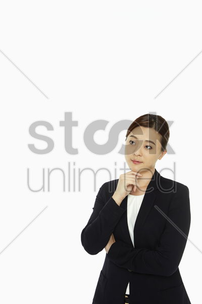businesswoman smiling and contemplating stock photo