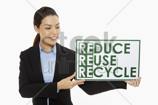 businesswoman smiling and holding up a placard stock photo
