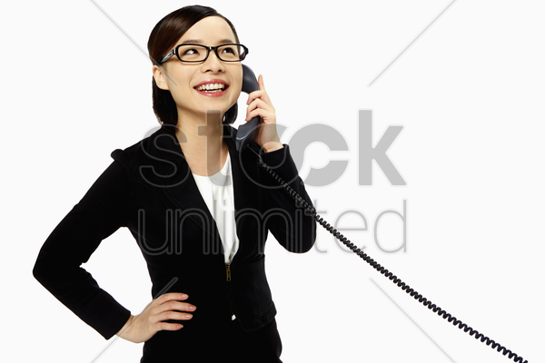 businesswoman smiling and talking on the phone stock photo