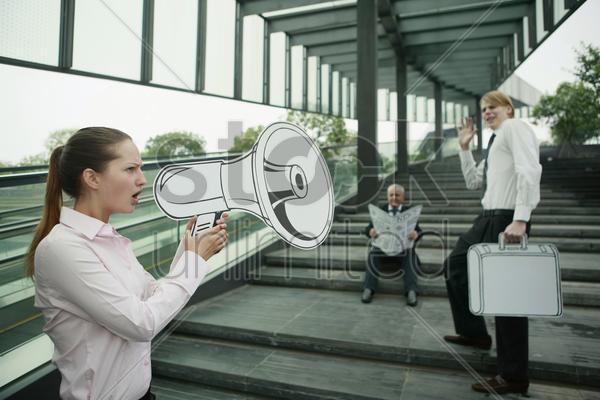 businesswoman speaking through megaphone stock photo