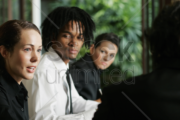 businesswoman speaking up in a meeting stock photo