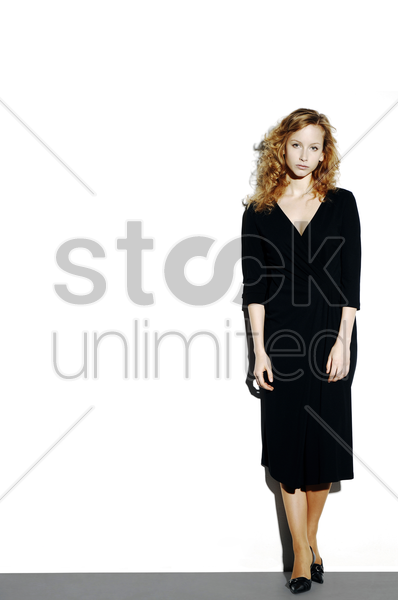 businesswoman standing alone stock photo