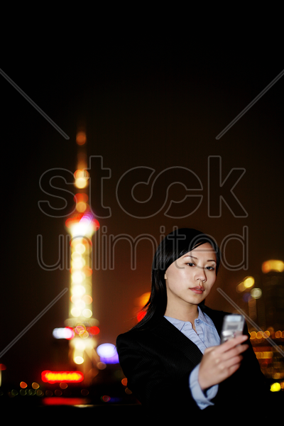 businesswoman taking her own picture with a camera phone stock photo