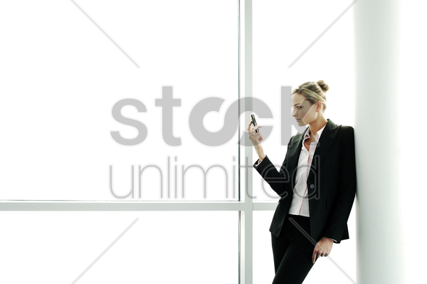 businesswoman taking picture with a cell phone stock photo