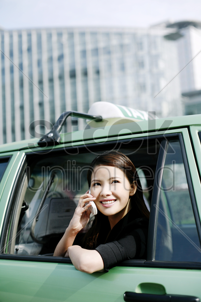 businesswoman talking on the hand phone in the taxi stock photo