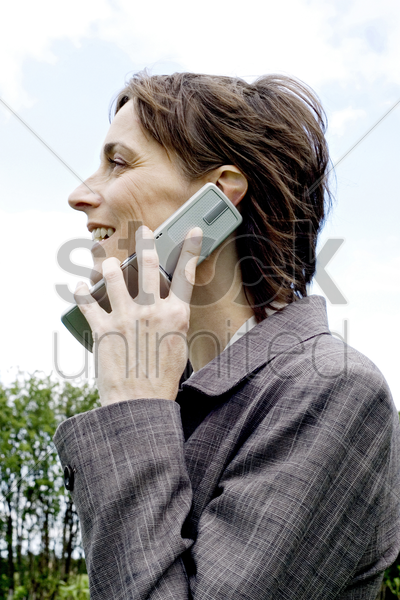 businesswoman talking on the mobile phone stock photo