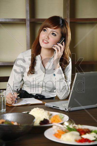 businesswoman talking on the phone stock photo