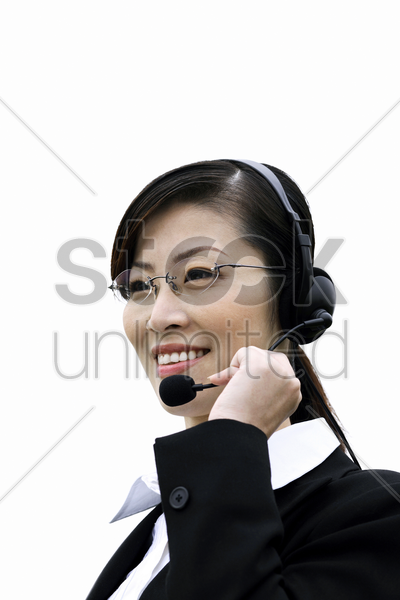 businesswoman talking on the telephone headset stock photo