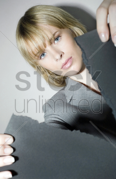 businesswoman tearing a paper stock photo