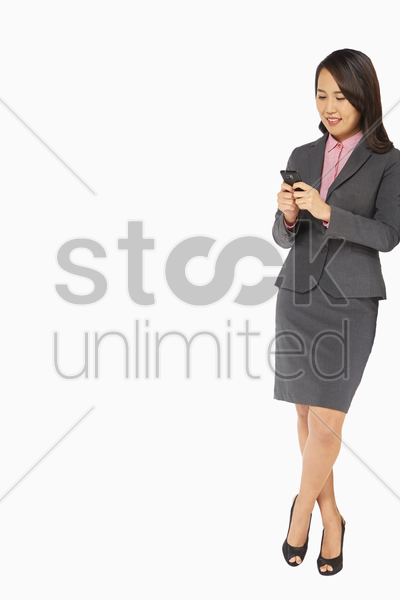 businesswoman text messaging stock photo