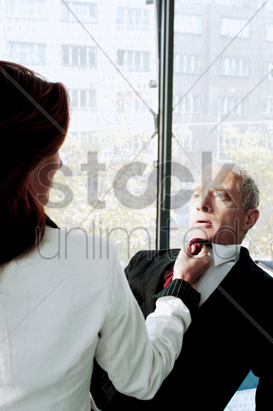 businesswoman threatening her colleague stock photo