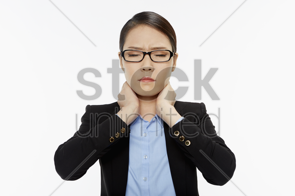 businesswoman touching her neck stock photo