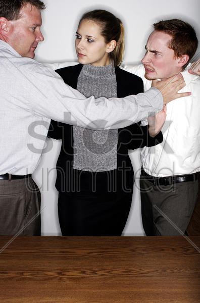 businesswoman trying to cool off two angry men stock photo