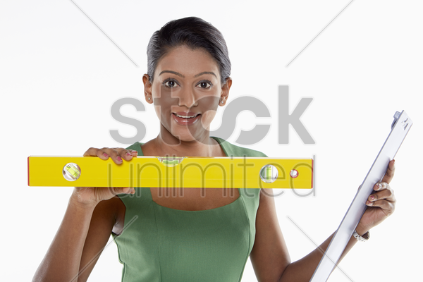 businesswoman using a measuring device stock photo