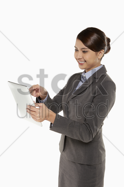businesswoman using digital tablet stock photo