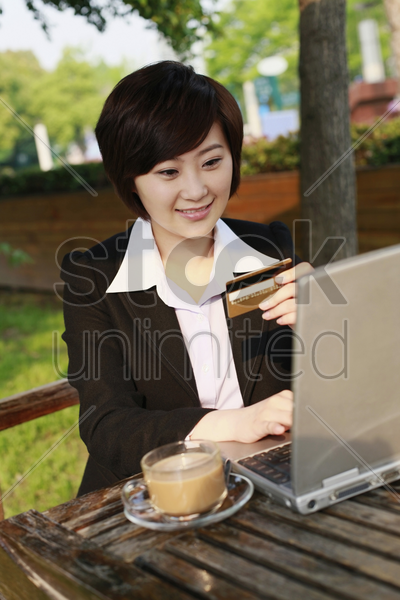 businesswoman using laptop to shop online stock photo