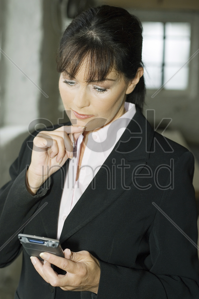 businesswoman using pda stock photo